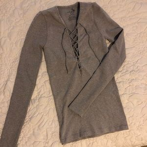 Free People grey long sleeve lace up top